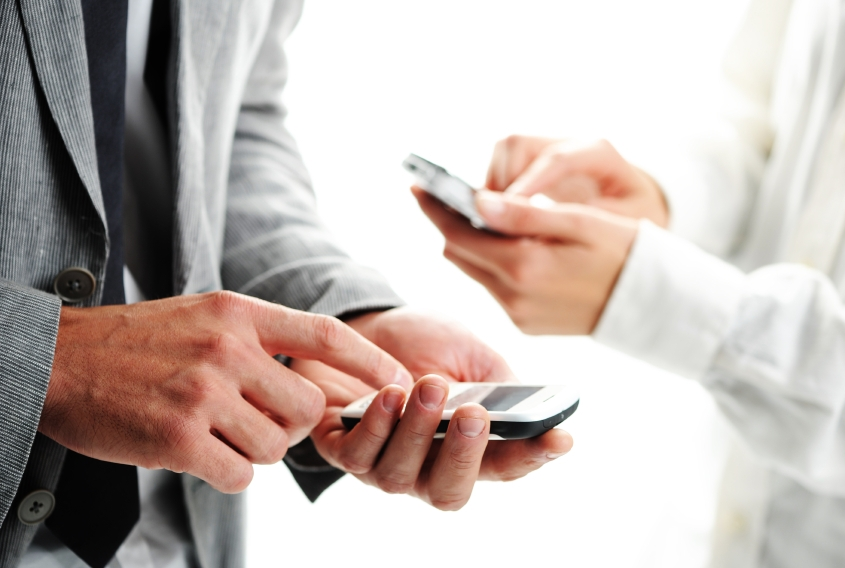 businesspeople text message on their mobile phones